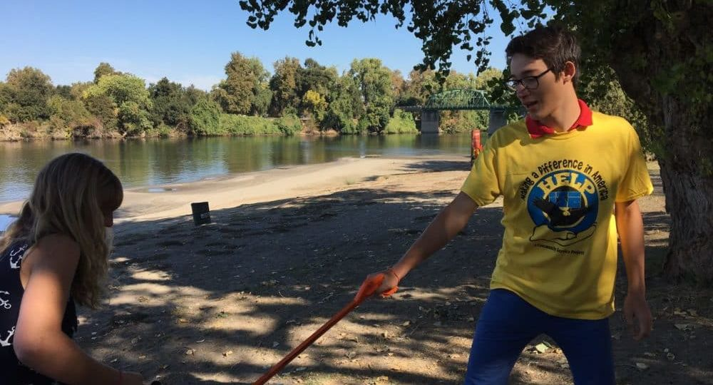 International exchange student volunteering to clean up park