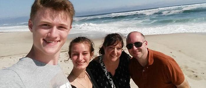 exchange student with host family on beach