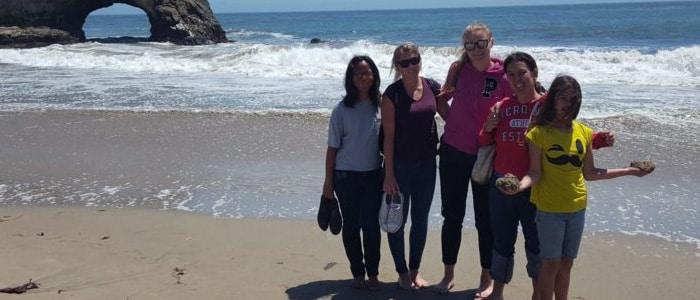 area representative taking exchange students to beach