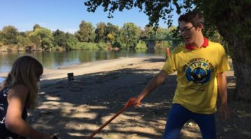 Exchange student volunteering to help clean up park and river