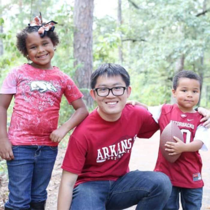 Exchange student with host siblings in Arkansas