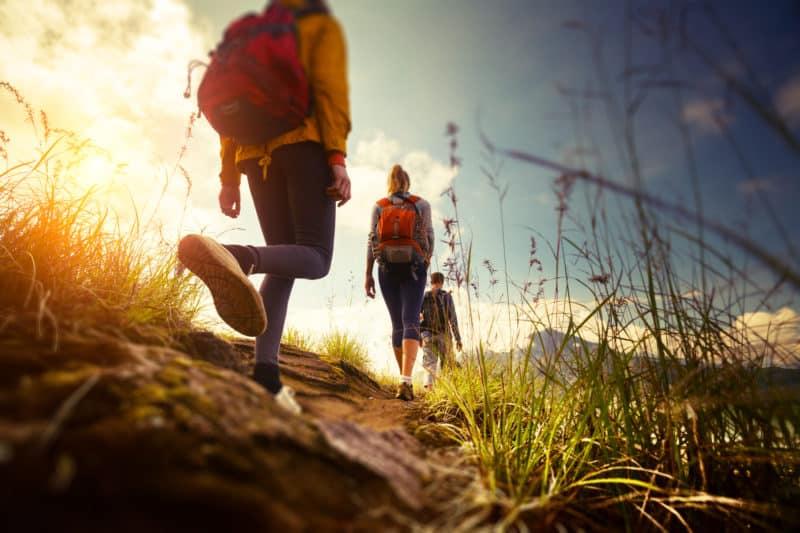Exchange students hiking along path