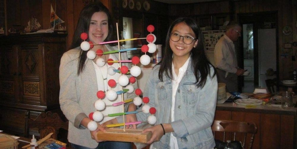 Exchange students making science project