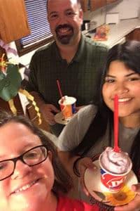 Host family having milkshakes with exchange student