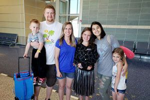 Host family welcoming their exchange student at the airport
