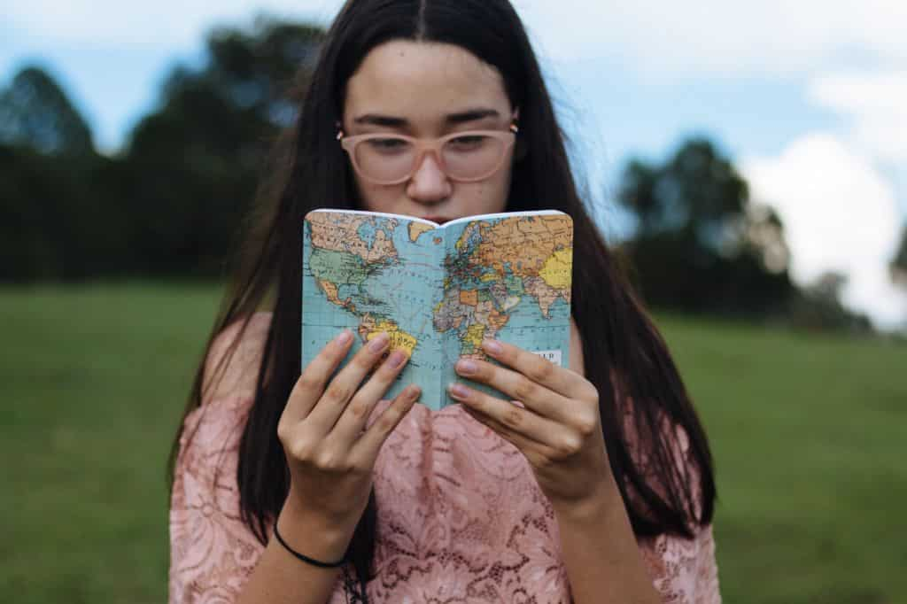 exchange student holding notebook